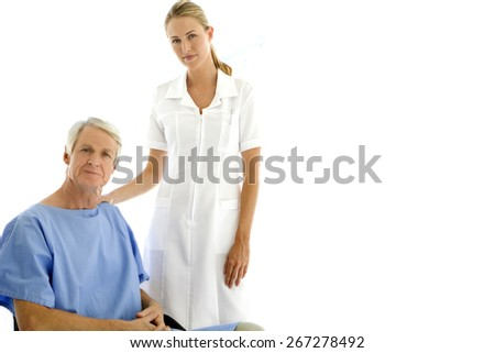 Gorgeous nurse with senior patient - stock photo