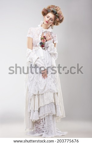Gorgeous Outre Female in Lacy White Dress with Flowers - stock photo