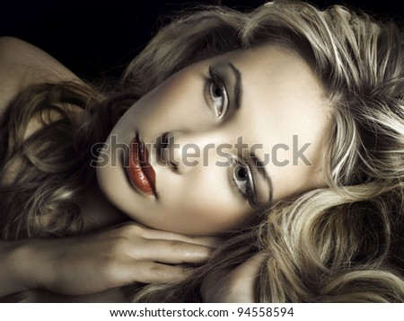 Gorgeous portrait of a young beautiful blonde woman - stock photo