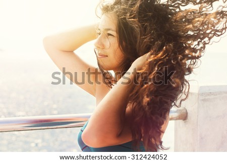 Gorgeous Romantic Girl Outdoors. Long Hair Blowing in the Wind. Backlit, Warm Color Tones. Selective focus - stock photo