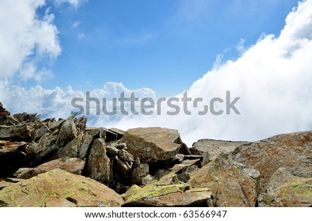 Gorgeous scenery, a combination of mountain rocks with a blue sky with cumulus clouds - stock photo