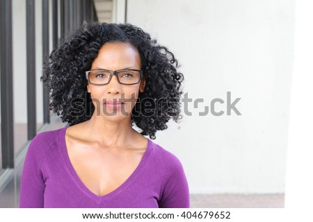 Gorgeous senior African American woman wearing glasses with copy space  - stock photo