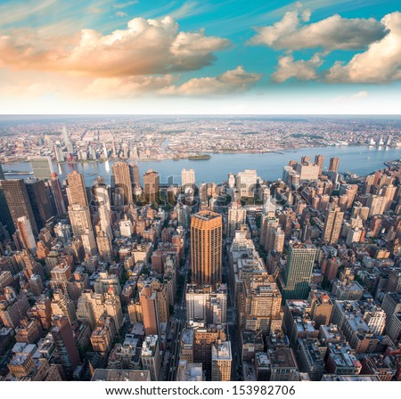 Gorgeous summer sunset over Manhattan Skyscrapers - New York City. - stock photo