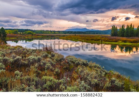 Gorgeous Sunrise, reflection in the water - Grand Tetons Oxbow Point