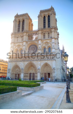 Gorgeous sunset over Notre Dame cathedral with puffy clouds, Paris, France - stock photo