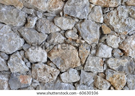 gorgeous unshaped background of a stone wall - stock photo
