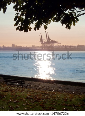 Gorgeous view at the port terminal  from the park sea walk side at sunset, sunrise time. Stanley Park, Vancouver, Canada. - stock photo