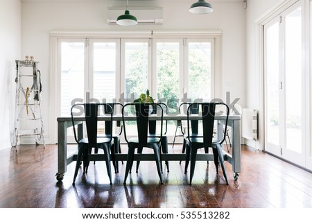 gorgeous vintage styled light bright dining room with bifold doors