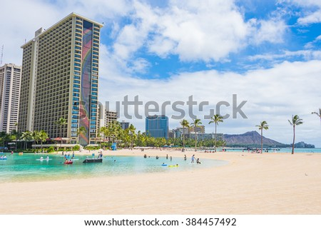 Gorgeous Waikiki golden beach with a beautiful building and a Diamond Head crater on the background.  - stock photo