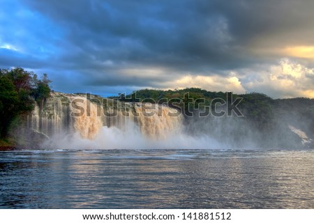 Gorgeous Waterfall at the Sunset in Blue Light - stock photo