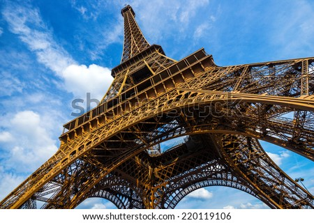 Gorgeous wide shot of Eiffel Tower with dramatic sky at late evening, Paris, France - stock photo
