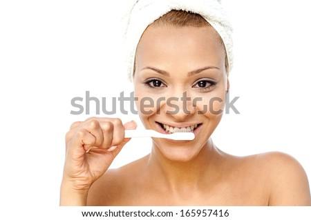Gorgeous woman brushing her teeth - stock photo