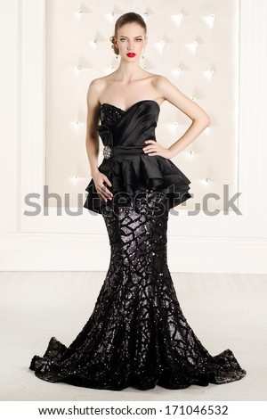 Gorgeous woman in black long dress - stock photo