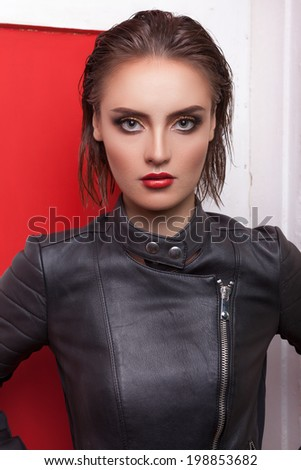 Gorgeous woman in leather. Professional make up and hairstyle. Studio lighting. High end retouching. Clean skin with texture - stock photo