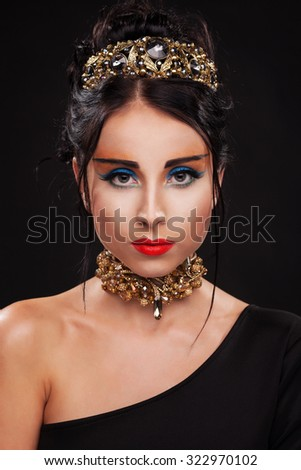 Gorgeous woman in luxury jewelry against black background