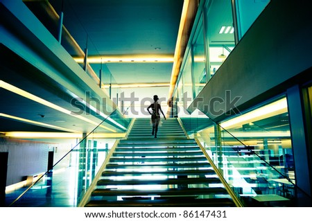 Gorgeous woman in modern stairs - stock photo