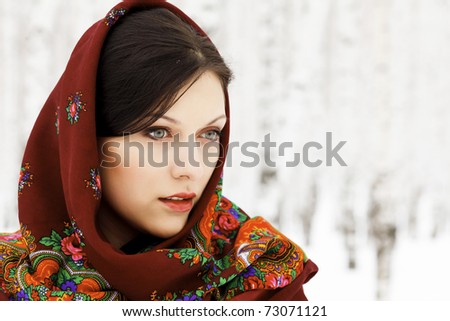 Gorgeous woman in shawl on her head - stock photo