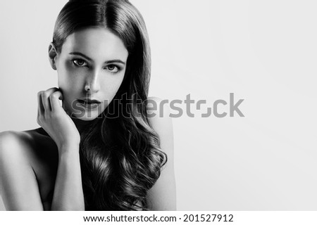 gorgeous woman looking at the camera black and white - stock photo