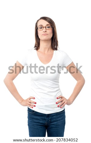 Gorgeous woman standing with hands on her waist - stock photo