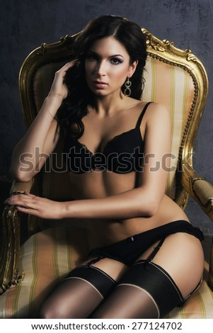 Gorgeous woman with a perfect body posing in lingerie.  - stock photo