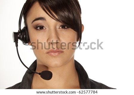 Gorgeous woman with a phone headset like used in voip and call centers - stock photo