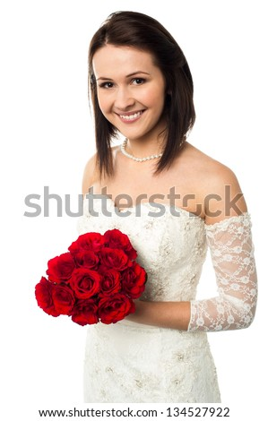 Gorgeous young bride with a rose bouquet isolated against white background. - stock photo