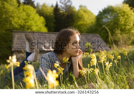 Gorgeous young brunette relaxing in the lap of nature. - stock photo