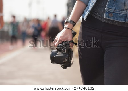 Gorgeous young brunette woman having photography fun.