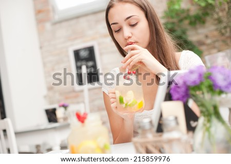 Gorgeous young brunette woman in a fancy restaurant. - stock photo