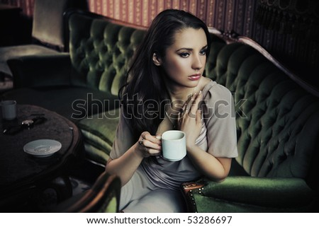 Gorgeous young lady drinking coffee - stock photo