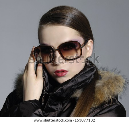 gorgeous young lady in sunglasses