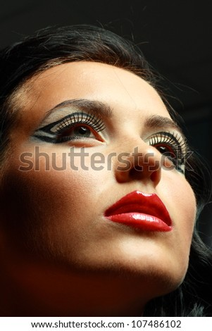 Gorgeous Young model beautiful women with perfect art make up and long false eyelashes. - stock photo