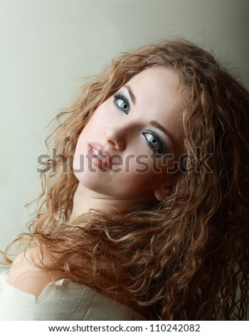 Gorgeous Young model beautiful women with perfect make up smoky eyes weared in rug - stock photo