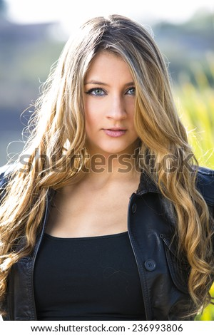 Gorgeous young model posing with a beautiful and sassy look with long blond hair - stock photo
