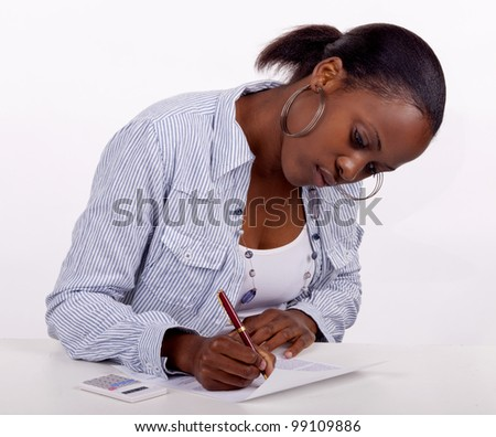 Gorgeous young South AFrican woman filling in a form. - stock photo