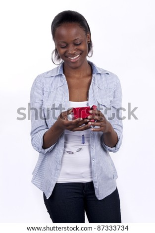 Gorgeous young South African woman holding a gift box. - stock photo