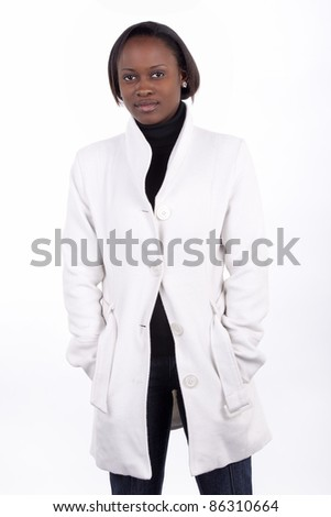 Gorgeous young South African woman in white coat on a white background. - stock photo
