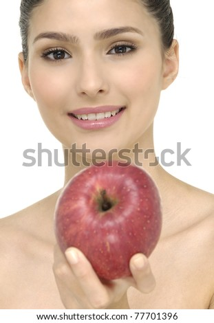 Gorgeous young woman holding a red apple