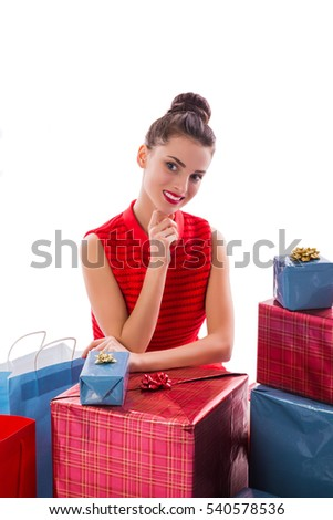 Gorgeous young woman in red dress and many gift boxes. Isolated on white