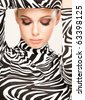 gorgeous young woman posing in zebra pattern outfit - stock photo