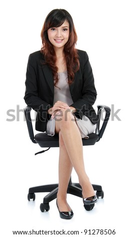 Gorgeous young woman sitting on a chair isolated over white background - stock photo