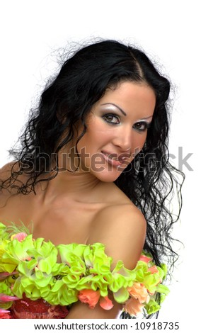 Gorgeous young woman wearing boa of green flowers isolated on white