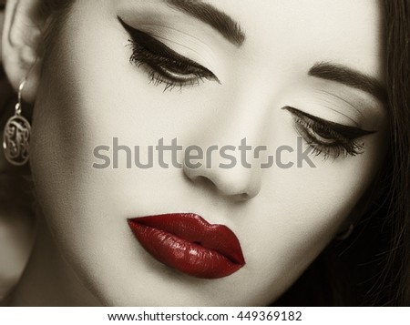 Gorgeous young woman with long eyelashes. Perfect makeup. Vintage style.