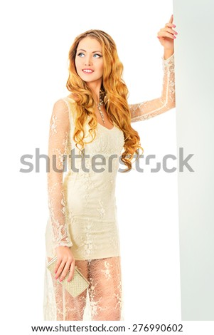 Gorgeous young woman with long hair posing in beautiful white dress. Make-up, cosmetics. Jewelry. Fashion shot. Isolated over white.  - stock photo