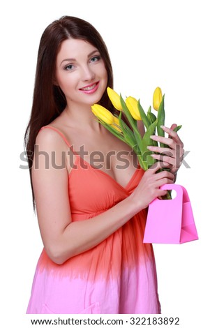 Gorgeous young woman with yellow tulips/Beautiful girl holding a bouquet of fresh flowers on Holiday