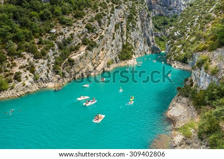 GORGES DU VERDON, FRANCE - AUGUST 15, 2015: People rowing and recreating in Verdon Gorge, on mouth of Le Verdon river, near Aiguines. Canyon is about 25 kilometres long and up to 700 metres deep. - stock photo