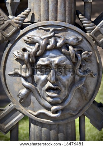 Gorgon head bas-relief - stock photo