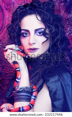 Gorgon. Young woman in dark creative image and with snake. - stock photo