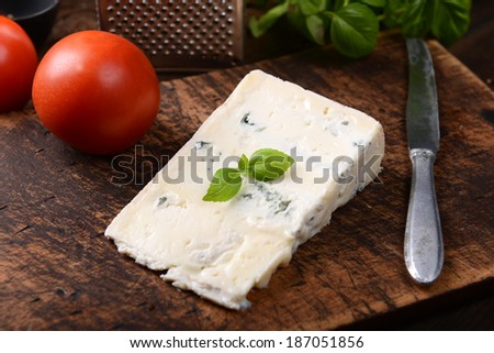 gorgonzola cheese on old wooden background