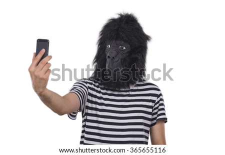Gorilla man taking photos with his phone. - stock photo